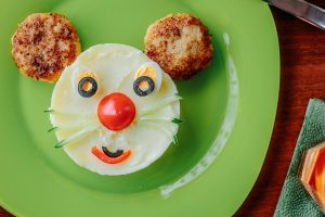 Top view of kid food - funny face made from potato puree and meat, great image for your needs.
